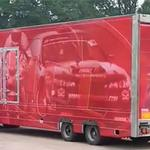 Visual marketing solutions. Vehicle graphics, shop fitting, shop removals merchandising. Lorry with red graphics.